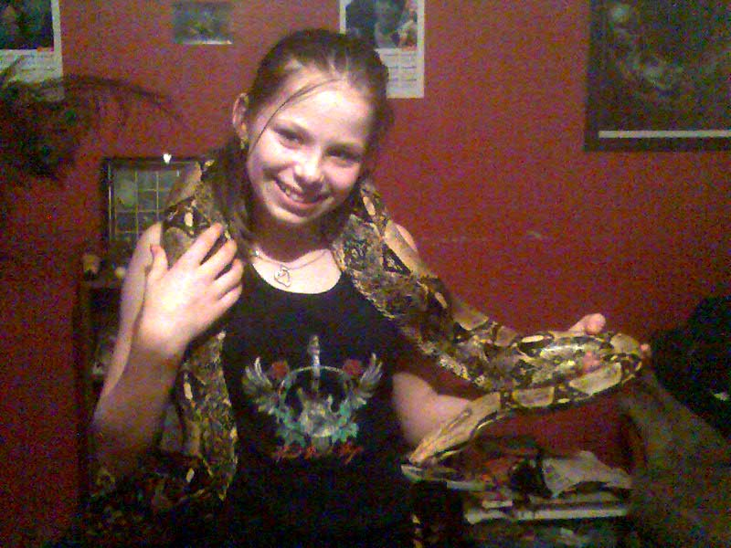 "Photo by Yvonne Evans of her daughter Jade with Curly the BCI boa he is 14 years old and 8' 6"" long."